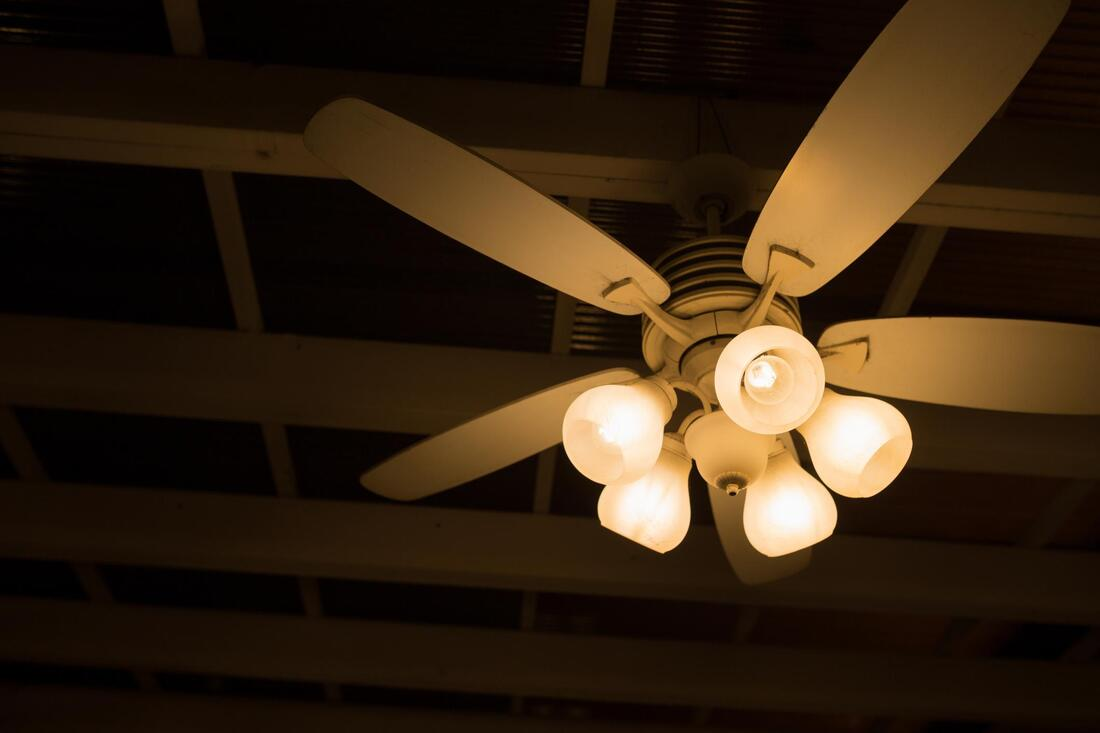 image of a ceiling fan prior to dust removal.